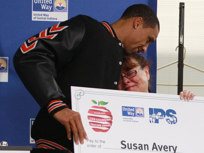 Indiana Pacer George Hill huggs his former teacher, Susan Avery, who was was presented an award for helping to change Hill's life.  Philanthropists, Al and Kathy Hubbard, along with Hill announced $25,000 prizes to recognize life-changing teachers in IPS.