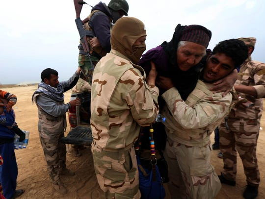 A Iraqi family fleeing the violence in the northern