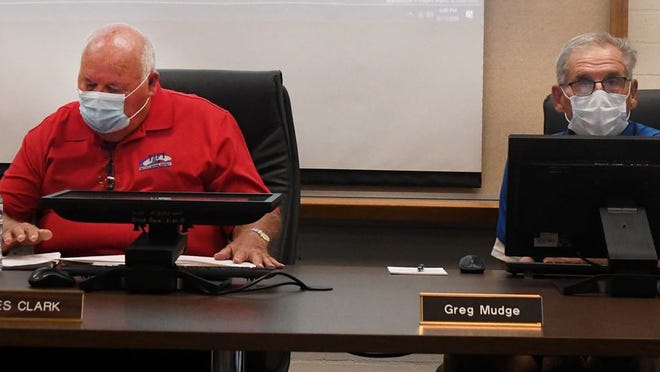 Taft City School Board members Les Clark  Jr. and Greg Mudge wearing face masks at board meeting Wednesday night