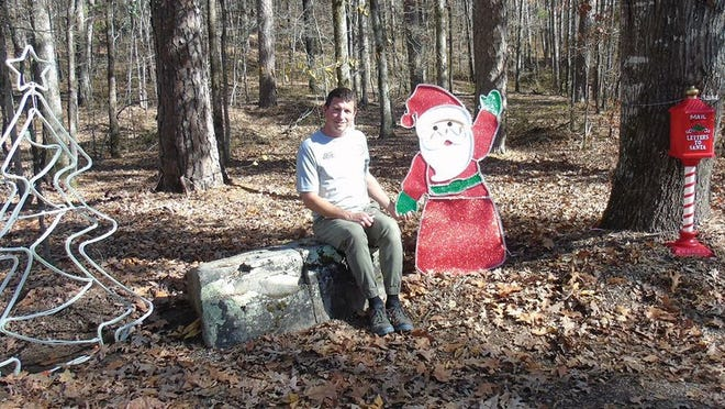Michael Bynaker, POA recreation, is one of many working to set up the Grove Park Christmas Tree Lighting scheduled for Dec. 4. Looks like he's the first one to get a photo opportunity with Santa.