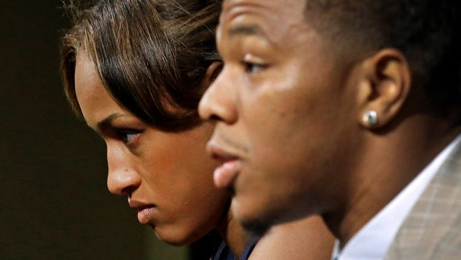 FILE - In this May 23, 2014, file photo, Janay Rice, left, looks on as her husband, Baltimore Ravens running back Ray Rice, speaks to the media during an news conference in Owings Mills, Md. Rice starts his two-game suspension Saturday, Aug. 30, 2014, missing the Ravensí home opener against Cincinnati and a key AFC North showdown in Pittsburgh. (AP Photo/Patrick Semansky, File) ORG XMIT: NY154