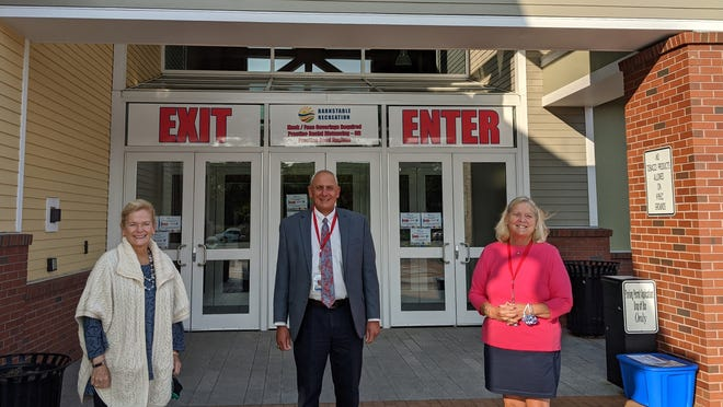 From the left are Coop CEO Lisa Oliver, Town Manager Mark Ells and Barnstable Rec Director Patti Machado.