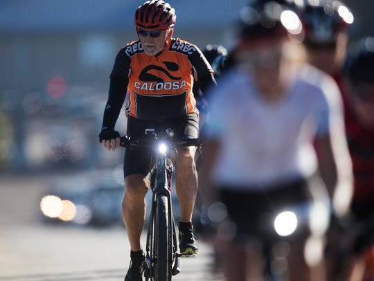 Larry Hickey crosses the Sanibel Causeway while on
