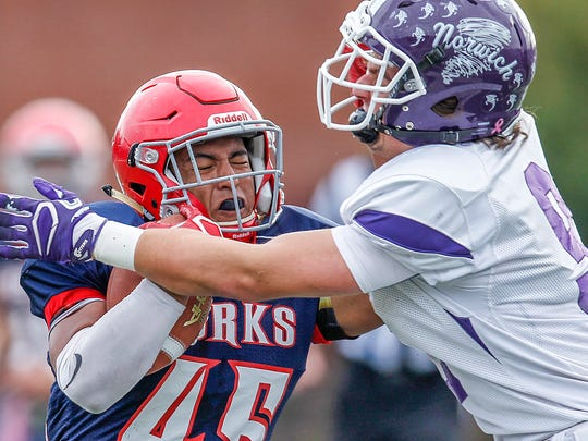 Chenango Forks' Jeremiah Allen runs into Norwich's Michael Carson during Saturday's Section 4 Class B final at Binghamton Alumni Stadium. Allen rushed for 272 yards and four touchdowns in Forks' 49-21 wiin,