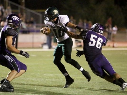 Photo by Hung Vu/Special to the Record Searchlight Shasta High's Nic Ariagno (right) returns on a Shasta defense that had the most improvement from 2012 to 2013.