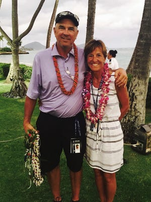 Mike and Jani Thomas pose outside the clubhouse at Wailalae Country Club in Honolulu, Sunday, jan. 15, 2017, after their son, Justin Thomas, set a 72-hole scoring record to win the Sony Open golf tournament. Mike Thomas is a club pro and his son's only coach. (AP Photo/Doug Ferguson)