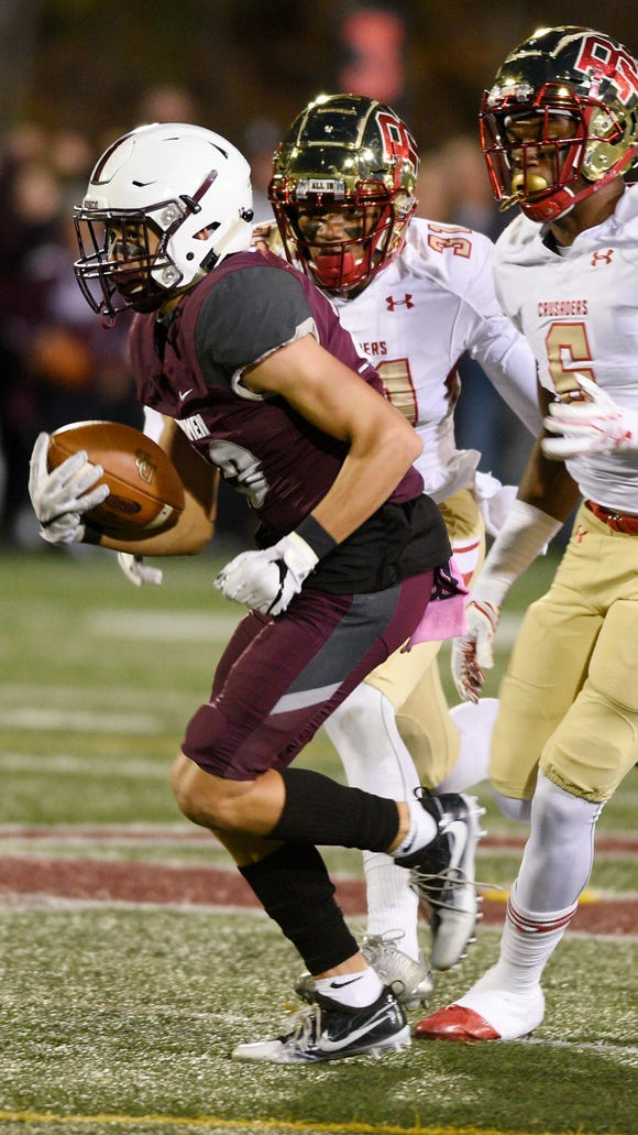 Don Bosco's Christian Dremel (13) runs for a first down after making a catch against Bergen Catholic in the second quarter of the game on Friday, Oct. 27, 2017.