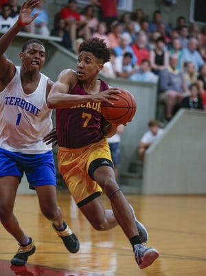 McCutcheon's Robert Phinisee (7) drives to the basket against Cathedral's Jarron Coleman (1) during the High School Basketball Hoosiers Reunion Classic at Hoosier Gym in Knightown, Indiana on Jun 1, 2018. (Michael Hickey for The Star)