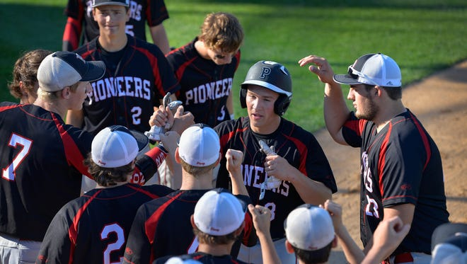 Pierz's Lane Girtz (8) is congratulated on his first run enroute to a 13-0 rout of Paynesville in the first inning of their State Class 2A quarterfinal game Thursday, June 16, at Dick Putz Field. Girtz had four hits and four runs.