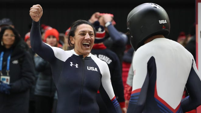 Elana Meyers Taylor and Lauren Gibbs  celebrate after winning silver in the women's bobsled during the Pyeongchang 2018 Olympic Winter Games at Olympic Sliding Centre on Feb. 21.