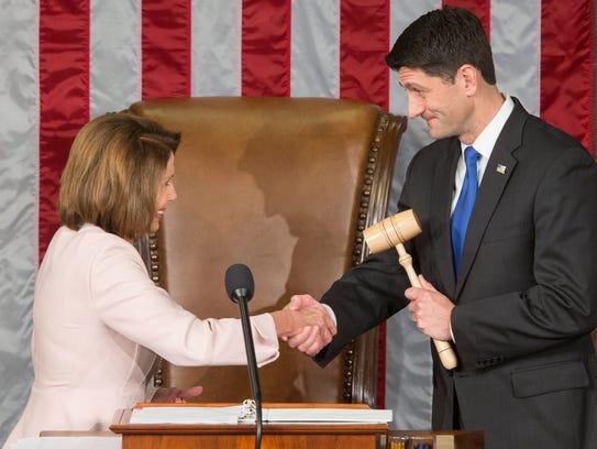 Pelosi hands the gavel to the Speaker Paul Ryan before