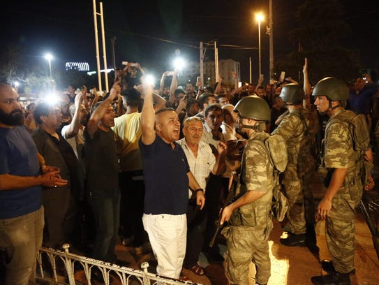 Supporters of Recep Tayyip Erdogan shout slogans at