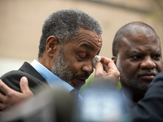 Anthony Ray Hinton wipes away tears outside of the