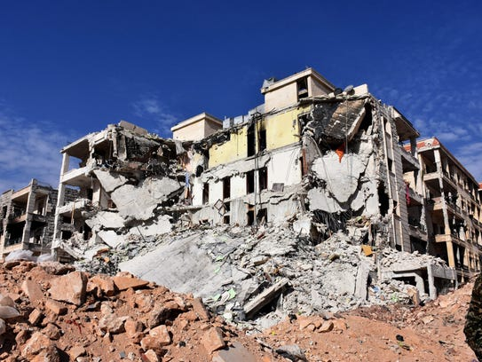Damaged buildings and rubble are seen in Aleppo's western