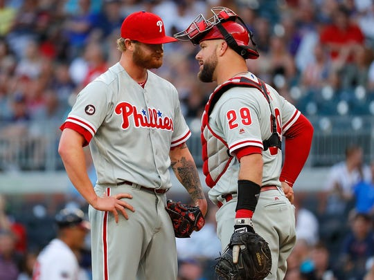 ATLANTA, GA - JUNE 08:  Ben Lively #49 and Cameron Rupp #29 of the Philadelphia Phillies meet at the mound in the first inning against the Atlanta Braves at SunTrust Park on June 8, 2017 in Atlanta, Georgia.  (Photo by Kevin C. Cox/Getty Images)
