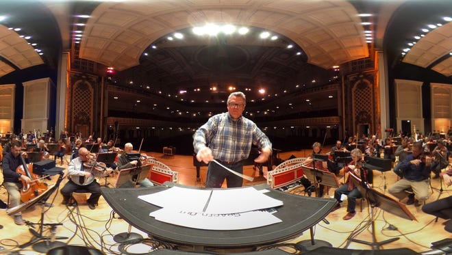 John Morris Russell conducts the Cincinnati Pops Orchestra during rehearsal.