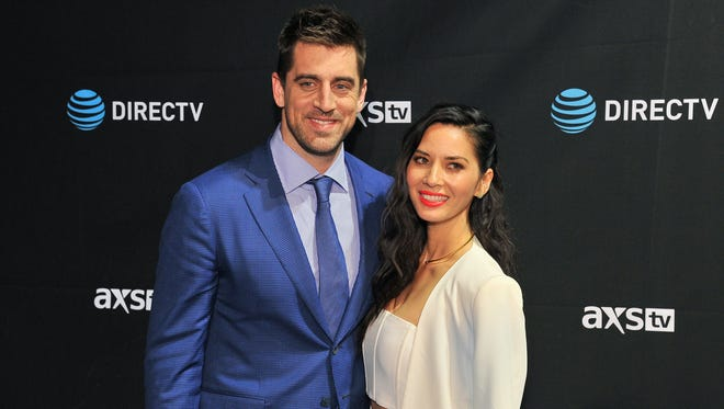 Green Bay Packers quarterback Aaron Rodgers and actress Olivia Munn are now a two-dog couple. They recently adopted a puppy named Frank.