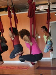 In Aerial Yoga, silks help students support their bodies