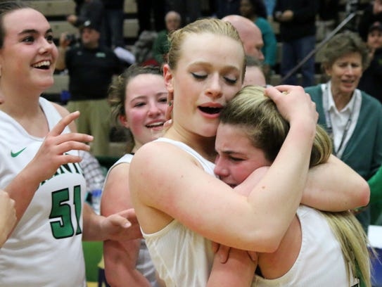 Ava McCann hugs Hannah Strawn after Seton Catholic