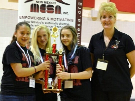 From left are Alejandra Orosco, Adriana Darrow and Katilyn Warczinski, along with MESA Team Sponsor Monika Velez. These Red Mountain Middle School students brought home a state title.