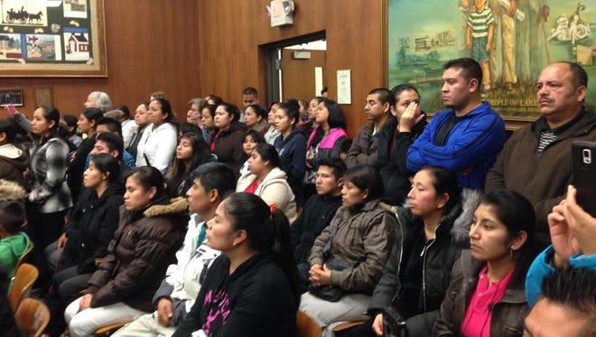 Latino parents concerned about looming busing cuts crowd the meeting room at Lakewood's Town Hall on Feb. 4, 2016.