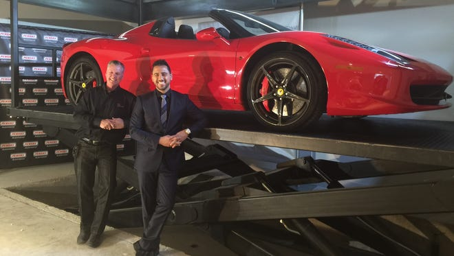 "Rod Cullum (left) of Cullum Homes and Josh Altman of Bravo's ""Million Dollar Listing LA"" stand in a car bar."