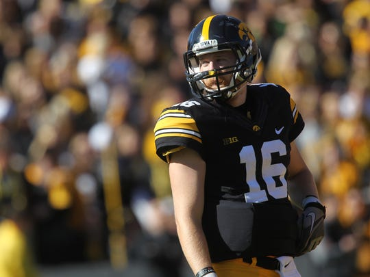 Iowa quarterback C.J. Beathard waits for the end of a T.V. timeout during the Hawkeyes' game against Wisconsin at Kinnick Stadium on Saturday, Oct. 22, 2016.