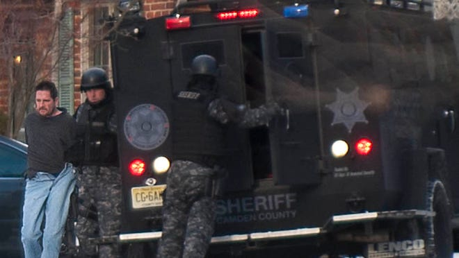 James Williams Jr. is brought out of a home on Addison Avenue in Haddon Township by members of the Camden County Sheriff's Department SWAT Team on Wednesday, January 7, 2015.