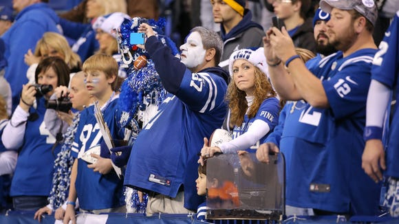 Colts fans watch the Colts warm up before Sunday's game against the Houston Texans at Lucas Oil Stadium.