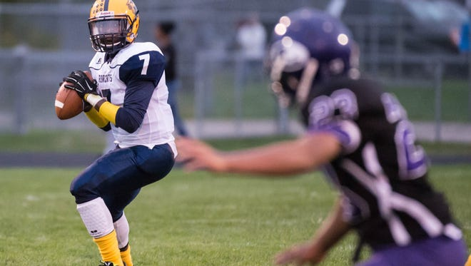 Battle Creek Central's DJ Watson (No. 7) throw a pass during Friday nights game against Lakeview.