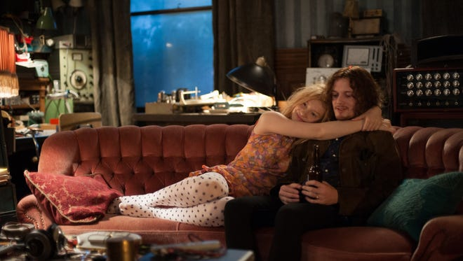 """This image released by Sony Pictures Classics shows Mia Wasikowska, left, and Anton Yelchin in a scene from """"Only Lovers Left Alive."""" The movie was partially filmed at the old Whitney mansion on Alfred Street in Detroit."""