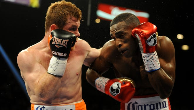 Canelo Alvarez, left, and Erislandy Lara exchange blows during a super welterweight fight at MGM Grand.