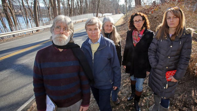 From left Ron Breland, Marge McLaughlin, Nancy Mahoney, Karen McGlinchey and Jennifer Gilbart stand in front of Lake DeForest, where Suez has put of silver wire fence up that residents are furious about in West Nyack on Feb. 6, 2017.