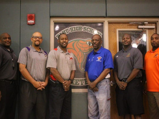 Ron Lang (blue shirt) has been coaching basketball in Tallahassee for more than 35 years, with stints at Rickards High, FAMU High, Nims Middle and Griffin Middle. Lang won three state titles with the Rattlers in the 1990's. His coaching legacy has produced standout players and community citizens. From left: Albert Arnold, Kendall Randolph, Rick Davis,  Lang, Anthony Robinson, Cornell Thomas.