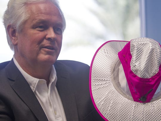 Andy Birutis holds up one of his sun hats at Alchemi Labs headquarters in Scottsdale on Sept. 30, 2016.