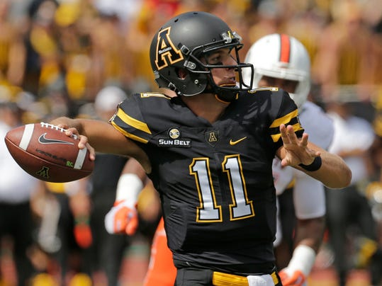FILE - In this Sept. 17, 2016, file photo, Appalachian State's Taylor Lamb (11) looks to pass against Miami during the first half of an NCAA college football game, in Boone, N.C. Appalachian State, which shared the Sun Belt title a season ago, is now the league's preseason favorite in 2017, according to a poll of coaches and selected media. (AP Photo/Chuck Burton, File)