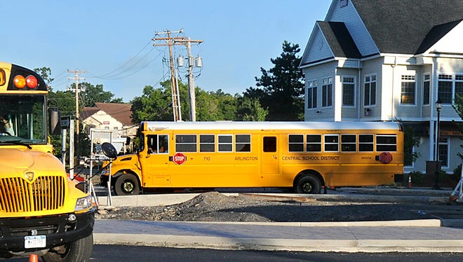 This file photo of Arlington Central School District school buses has been cropped