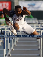 La Quinta High School senior Koty Burton won titles in both the 110-meter hurdles and the 300-meter hurdles, including an impressive last few meters of the 110's, pictured here, where he came from behind Upland junior Joseph Anderson, to edge him at the line with a time of 14.06 seconds to Anderson's 14.08.