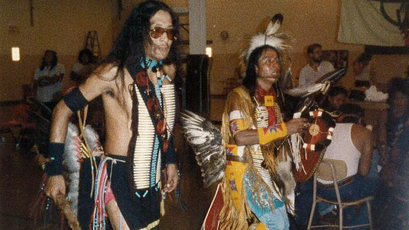 George Blue Bird (left) participates in a tribal ceremony