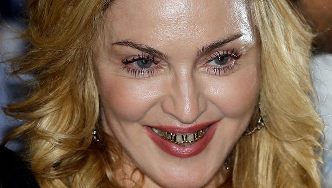 Madonna smiles during her visit to the Hard Candy Fitness center in Rome on Wednesday.