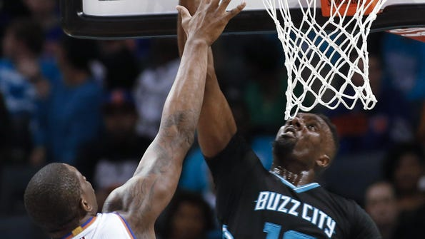Charlotte Hornets forward P.J. Hairston scores against