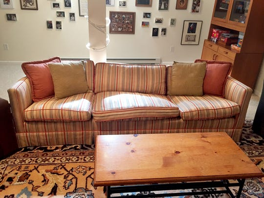 The Scalamandre couch in the land of dead furniture: the basement.