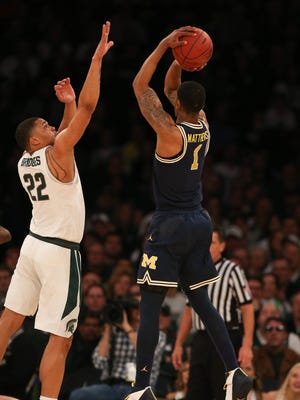 Michigan State forward Miles Bridges defends Michigan forward Charles Matthews in a Big Ten tournament semifinal March 3, 2018 at Madison Square Garden in New York.