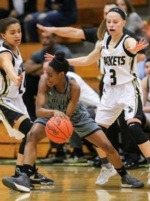 T.L.Hanna freshman wing Maleia Bracone, left, and guard Khloe Saunders, right, guard Clover guard Amber Lipscomb during the second quarter on Friday at T.L. Hanna High School in Anderson. T.L Hanna was eliminated from the playoffs with the 62-55 Clover win.