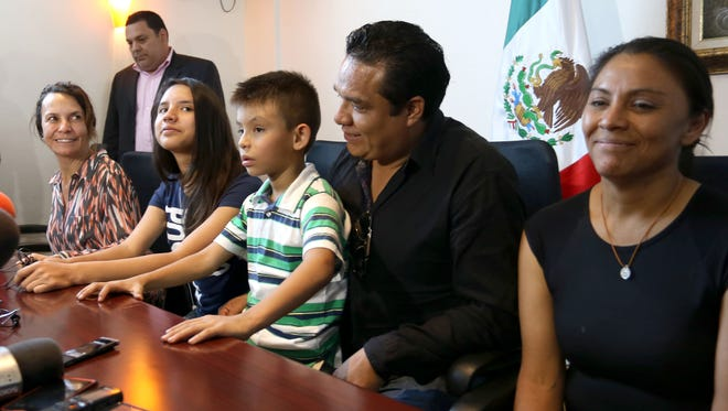 Alondra Luna Nunez, second from left, attends a press conference with her parents, right, Gustavo Luna and Susana Nunez, after landing at the Guanajuato International Airport in Silao, Mexico, Wednesday, April 22, 2015. The 14-year-old Mexican girl, who was taken from her school by police and sent kicking and screaming to the U.S., returned home after DNA tests showed she is not related to an American woman searching for her missing daughter. There was no immediate explanation of why authorities did not confirm her identity before sending her out of the country. The woman at far left is an unidentified human rights worker. (AP Photo/Mario Armas)