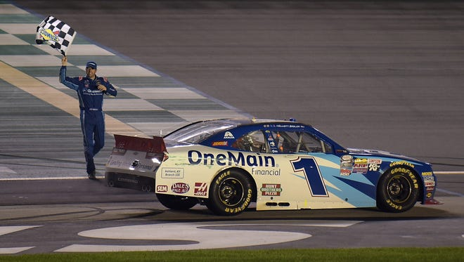 Elliott Sadler, driver of the #1 OneMain Chevrolet, celebrates with the checkered flag after winning the NASCAR XFINITY Series VisitMyrtleBeach.com 300 at Kentucky Speedway on September 24, 2016 in Sparta, Kentucky.  (Photo by Jonathan Moore/NASCAR via Getty Images)