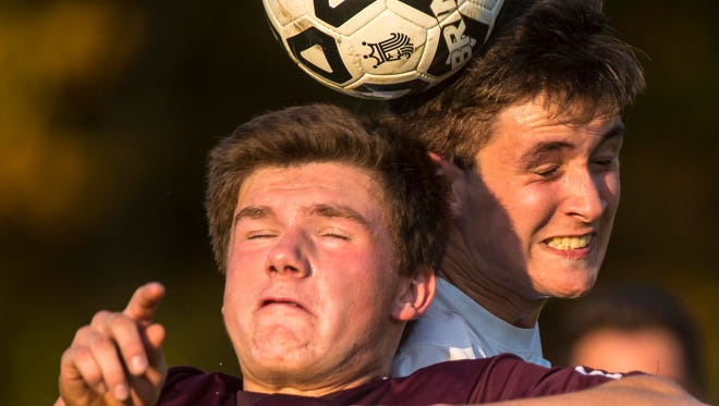 MMU's Jonas Muser, right, and North Country's Derrick Breault contest a header in Jericho on Tuesday, October 18, 2016.