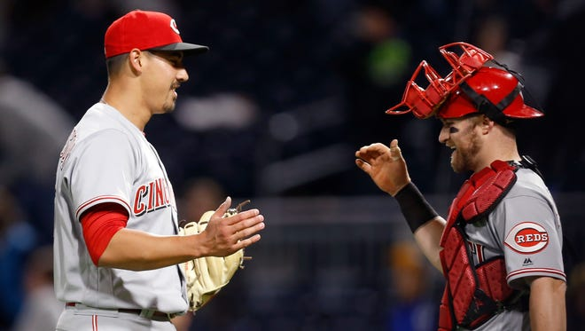 Cincinnati Reds starting pitcher Robert Stephenson, left, is greeted by catcher Tucker Barnhart after getting the last out in the ninth inning of a baseball game against the Pittsburgh Pirates, Wednesday, April 12, 2017, in Pittsburgh. The Reds won 9-2. (AP Photo/Keith Srakocic)