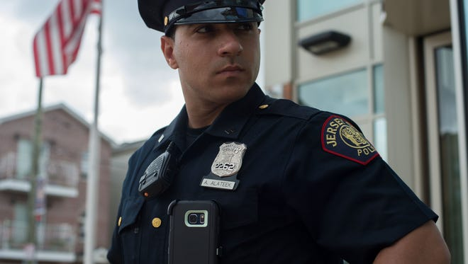 Jersey City police officer Ameer Alateek displays a smartphone that works as a body camera on June 23, 2017. The phone uses an app developed by the Igarapé Institute, a Brazilian think tank, and Jigsaw, a technology incubator created by Google, that is being tested for the first time in the U.S.
