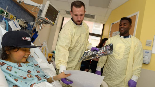Boston Cannons Kyle Denhoff, center, and Trevor Baptiste visit Hannah at Boston Children's Hospital in June. U.S. News & World Report just listed the hospital as the best children's hospital in the country.